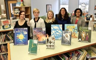 Staff and adopter with adopted books