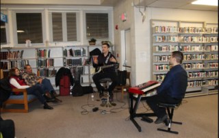"Abe Ovadia explains a bit about the composition of jazz music Friday night at ""Jazz in the Stacks"" at the La Plata branch of the Charles County Public Library."